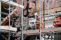 Emergency personnel attend an incident where a construction worker was injured whilst working on a building site. He is on the first floor of the scaffolding with serious head injuries. This image may only be used to portray the subject in a positive manner..©shoutpictures.com..john@shoutpictures.com