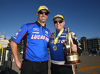 Apr 12, 2015; Las Vegas, NV, USA; Crew chief Aaron Brooks (left) and NHRA top fuel driver Richie Crampton celebrate after winning the Summitracing.com Nationals at The Strip at Las Vegas Motor Speedway. Mandatory Credit: Mark J. Rebilas-