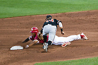 Indiana Hoosiers outfielder Justin Cureton (22) attempts to steal second base as Oregon State second baseman Andy Peterson (14) tags him during Game 9 of the 2013 Men's College World Series  on June 19, 2013 at TD Ameritrade Park in Omaha, Nebraska. The Beavers defeated the Hoosiers 1-0, eliminating Indiana from the tournament. (Andrew Woolley/Four Seam Images)