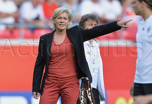 17.07.2013. Kalmar, Sweden.  German coach Silvia Neid walks on the field before the UEFA Women's EURO 2013 Group B soccer match between Germany and Norway at the Kalmar Arena in Kalmar, Sweden, 17 July 2013.