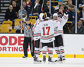 Tyler McNeely (Northeastern - 94), Steve Silva (Northeastern - 17), Wade MacLeod (Northeastern - 19) - The Northeastern University Huskies defeated the Harvard University Crimson 4-0 in their Beanpot opener on Monday, February 7, 2011, at TD Garden in Boston, Massachusetts.