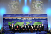 Washington, DC - November 15, 2008 -- World leaders pose for a group photo at the start of the Summit on Financial Markets and the World Economy at the National Building Museum in Washington, D.C., USA, 15 November 2008. The photo was retaken after Fernandez de Kirchner joined the group. Back row, from left to right: Mario Draghi, Chairman, Financial Security Forum; Ban Ki-Moon, Secretary-General of the United Nations; Silvio Berlusconi, President of Italy; Jose Manuel Barroso, President of the European Commission; Gordon Brown, Prime Minister of the United Kingdom; Angela Merkel, Chancellor of Germany; Jose Luis Rodriguez Zapatero, President of Spain and President of the European Council; Recep Tayyip Erdogan, Prime Minister of Turkey; Dr. Manmohan Signh, Prime Minister of India; Steven Harper, Prime Minister of Canada; Kevin Rudd, Prime Minister of Australia; Taro Aso, Prime Minister of Japan; Robert Zoellick, President, World Bank Group; and Dominique Strauss-Kahn, Managing Director, International Monetary Fund (IMF).  Front row, from left to right: Jan Kees de Jager Deputy Secretary of Finance, the Netherlands; Dimitry A. Medvedev, President of Russia; Felipe Calderon Hinojosa, President of Mexico; Susilo Bamgang Yudhoyono , President of Indonesia; Luiz Inacio Lula da Silva, President of Brazil; George W. Bush, President of the United States; Hu Jintao, President of China; Abdullah bin Abd al-Aziz Al Saud, King of Saudi Arabia; Nicolas Sarkozy, President of France; Lee Myung-bak, President of the Republic of Korea; and Kgalema Motlanthe, President of South Africa..Credit: Matthew Cavanaugh - Pool via CNP