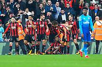 Jordon Ibe of AFC Bournemouth on floor is congratulated on scoring to make the score 2-1 during AFC Bournemouth vs Arsenal, Premier League Football at the Vitality Stadium on 14th January 2018