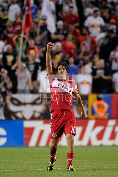 Sebastian Grazzini (10) of the Chicago Fire celebrates scoring. The New York Red Bulls and the Chicago Fire played to a 2-2 tie during a Major League Soccer (MLS) match at Red Bull Arena in Harrison, NJ, on August 13, 2011.