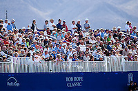 Multitues  gather on the 18th green stands of The 2010 Bob Hope Classic to witness Bill Haas win his first PGA event in La Quinta's PGA West Palmer Private golf course.