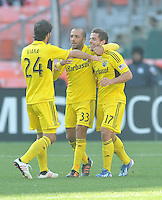 Ben Speas (17) of  Columbus Crew celebrates with teammates Federico Higuain and Agustin Viana his score in the 58th minute of the game. The Columbus Crew defeated D.C. United  2-1, at RFK Stadium, Saturday March 23, 2013.