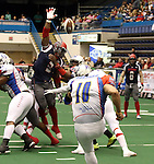 SIOUX FALLS, SD - JUNE 7 Tyler Knight #3 from the Sioux Falls Storm leaps to attempt to block the field goal attempt of Zeke Arevalo #10 from the Texas Revolution in the second quarter of their game Saturday night at the Sioux Falls Arena. (Photo by Dave Eggen/Inertia)
