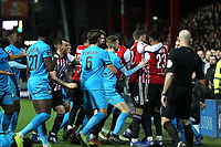 Referee Roger East keeps a close eye on a brawl in the second half which resulted in three players receiving a yellow card during Brentford vs Barnet, Emirates FA Cup Football at Griffin Park on 5th February 2019