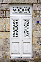 Ornate doorway in Domfront medieval town, Normandy, France