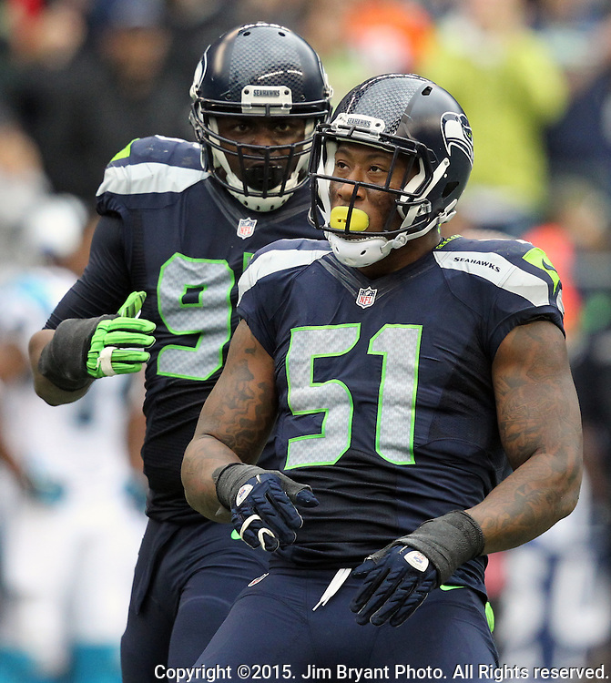Seattle Seahawks linebacker Bruce Irvin (51) celebrates after sacking Carolina Panthers Kam Newton (1) at with defensive end DeMarcus Dobbs (95) CenturyLink Field in Seattle on October 18, 2015. The Panthers came from behind with 32 seconds remaining in the 4th Quarter to beat the Seahawks 27-23.  ©2015 Jim Bryant Photography. All Rights Reserved.
