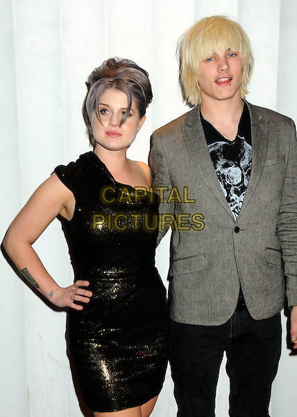 KELLY OSBOURNE & LUKE WORRALL.My Friend's Place Charity Clothing Drive Hosted by Kelly Osbourne held at Mi6 Night Club, West Hollywood, California, USA..May 26th, 2010  .half length dress hand on hip green sequins sequined one shoulder black purple grey gray  tinted dyed hair trousers grey gray suit jacket couple .CAP/ADM/BP.©Byron Purvis/AdMedia/Capital Pictures.