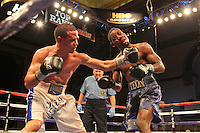 """ATLANTIC CITY, NJ - MARCH 26: Jorge Diaz punches Teon Kennedy during their USBA Super Bantamweight bout during Top Rank's """"Featherweight Fury"""" on March 26, 2011 at Boardwalk Hall in Atlantic City, New Jersey. (Photo by Hunter Martin/Getty Images) *** Local Caption *** Jorge Diaz;Teon Kennedy.."""