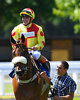 Winner of The Inspire Foundation Veterans' Handicap   Rio Ronaldo (r) ridden by Adrea Atzeni and trained by Mike Murphyis led into the winners enclosure during Whitsbury Manor Stud Bibury Cup Day Racing at Salisbury Racecourse on 27th June 2018