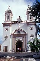 People entering the Templo de Santa Veracruz church in Taxco, Guerrero, Mexico