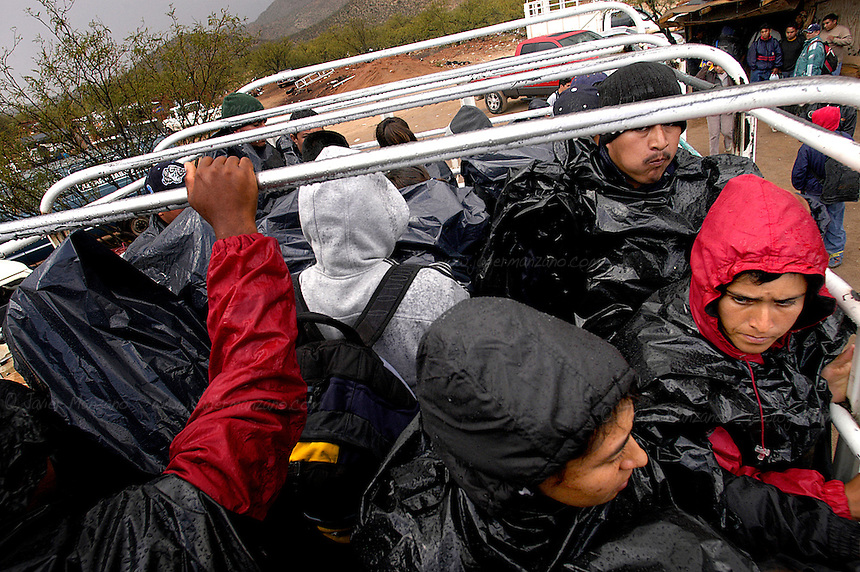 "A bus packed with as much as thirty immigrants leaves ?La Ladrillera?, the last pocket of civilization where supplies, water and a last minute ""coyote"" or guide can be purchased before they make their way to the many entry points along to the Arizona / Mexico border."