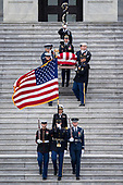 The flag-draped casket of former President George H. W. Bush is carried by a joint services military honor guard down the steps of the U.S. Capitol, Wednesday, Dec. 5, 2018, in Washington. (Sarah Silbiger/The New York Times via AP, Pool)<br /> Credit: Sarah Silbiger / Pool via CNP