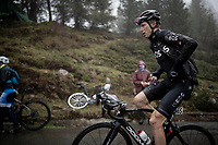 Christian Knees (DEU/Ineos) up the extremely wet, cold & misty Cole di Mortirolo <br /> <br /> Stage 16: Lovere to Ponte di Legno (194km)<br /> 102nd Giro d'Italia 2019<br /> <br /> ©kramon