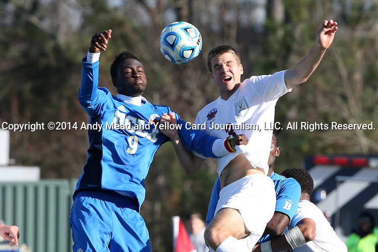14 December 2014: UCLA's Abu Danladi (GHA) (9) and Virginia's Matt Brown (3). The University of Virginia Cavaliers played the University of California Los Angeles Bruins at WakeMed Stadium in Cary, North Carolina in the 2014 NCAA Division I Men's College Cup championship match. Virginia won the championship by winning the penalty kick shootout 4-2 after the game ended in a 0-0 tie after overtime.