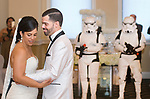 WATERBURY, CT-081217JS07-- Bride and groom, Francheska Lopez Morgado and Alexander Morgado share their first dance under the watchful eye of Storm Troopers during their Star Wars themed wedding Saturday at the community room at Holy Trinity Church in Waterbury. <br />  Jim Shannon Republican-American
