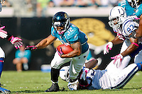 October 03, 2010:   Jacksonville Jaguars running back Maurice Jones-Drew (32) dives for yardage during 1st half AFC South Conference action between the Jacksonville Jaguars and the Indianapolis Colts at EverBank Field in Jacksonville, Florida.   Jacksonville defeated Indianapolis 31-28........