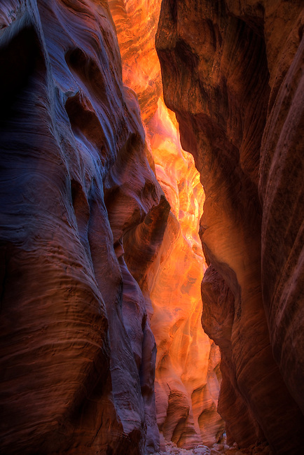 The midday sun illuminates the various hues on the sandstone walls of Buckskin Gulch in Southern Utah