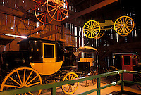 NY, New York, Mumford, Horse-drawn carriages displayed inside the Carriage Museum at Genesee Country Village & Museum