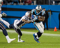 The Carolina Panthers play the New England Patriots at Bank of America Stadium in Charlotte North Carolina on Monday Night Football.  The Panthers defeated the Patriots 24-20.  Carolina Panthers running back DeAngelo Williams (34), New England Patriots cornerback Aqib Talib (31)
