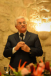 Palestinian President Mahmoud Abbas (Abu Mazen) attends a dinner of a Holiday Christmas for eastern calendar, in the West Bank city of Bethlehem, January 6, 2014. Photo by Thaer Ganaim