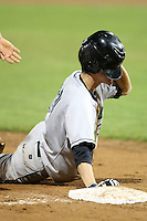 September 5, 2009:  Shortstop Chris Wade (23) of the Jamestown Jammers almost loses his helment after doing a face pant while sliding into third base during a game at Dwyer Stadium in Batavia, NY.  The Jammers are the NY-Penn League Short-Season Class-A affiliate of the Florida Marlins.  Photo By Mike Janes/Four Seam Images