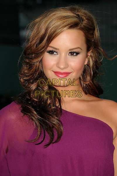 DEMI LOVATO .25th Annual Padres Contra El Cancer Benefit Gala held at The Hollywood Palladium, Hollywood, California, USA, 23rd September 2010..portrait headshot hair make-up red lipstick beauty  one shoulder purple  sleeve.CAP/ADM/BP.©Byron Purvis/AdMedia/Capital Pictures.