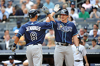 Tampa Bay Rays outfielder Desmond Jennings #8 is greeted by team mate Elliot Johnson #9 after hiting a home run during a game against the New York Yankees at Yankee Stadium on September 21, 2011 in Bronx, NY.  Yankees defeated Rays 4-2.  Tomasso DeRosa/Four Seam Images
