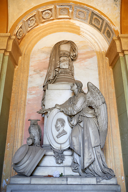 Picture and image of a classical style stone angel sculpture by sculptor  Santo Varni (Genoa, 1807 – 1885), The monumental tombs of the Staglieno Monumental Cemetery, Genoa, Italy