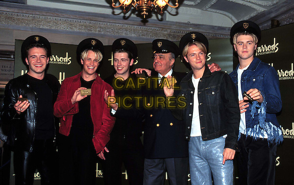 WESTLIFE.Open Harrods Summer Sale With Mohamed Al Fayed.Ref: 9822.boyband, wearing hats, half length, half-length.*RAW SCAN - photo will be adjusted for publication*.www.capitalpictures.com.sales@capitalpictures.com.© Capital Pictures