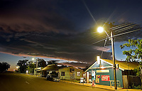 A street lamp lit at dawn reveals an empty Main Street of Wyndham AU in the northern most town in the Kimberley region.