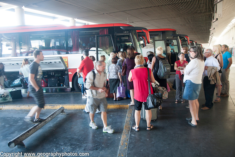 Passengers boarding long distance coach at Granada bus station, Spain