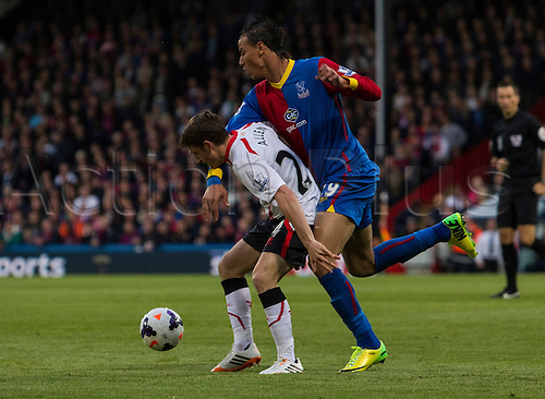 05.05.2014  London, England. Crystal Palace forward Marouane Chamakh (29) and Liverpool midfielder Joe Allen (24) during the Barclays Premier League match between Crystal Palace and Liverpool from Selhurst Park