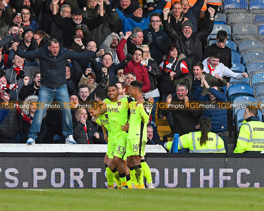 David Wheeler of Exeter City (l) celebrates his goal with team mates and fans during Portsmouth vs Exeter City, Sky Bet EFL League 2 Football at Fratton Park on 28th January 2017