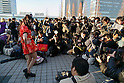 Photographers take pictures of a cosplayer during the Comic Market 91 (Comiket) event at Tokyo Big Sight on December 29, 2016, Tokyo, Japan. Manga and anime fans arrived in the early morning hours on the opening day of the 3-day long event. Held twice a year in August and December, the Comiket has been promoting manga, anime, game and cosplay culture since its establishment in 1975. (Photo by Rodrigo Reyes Marin/AFLO)