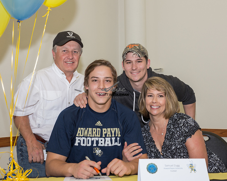 Sammy Zugg signs a letter of intent to play football at Howard Payne University, at Vandegrift High School's signing ceremony on April 23, 2015.