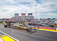 Sep 4, 2016; Clermont, IN, USA; NHRA top fuel driver Leah Pritchett (near) races alongside Steve Torrence during qualifying for the US Nationals at Lucas Oil Raceway. Mandatory Credit: Mark J. Rebilas-USA TODAY Sports
