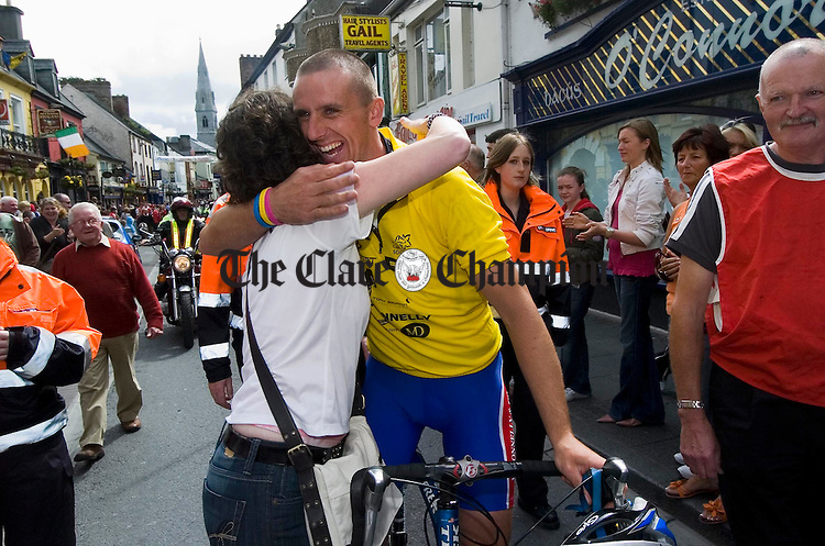 Tony Griffin is welcomed home by his sister Angela on his completion of his charity cycle. Photograph by John Kelly.