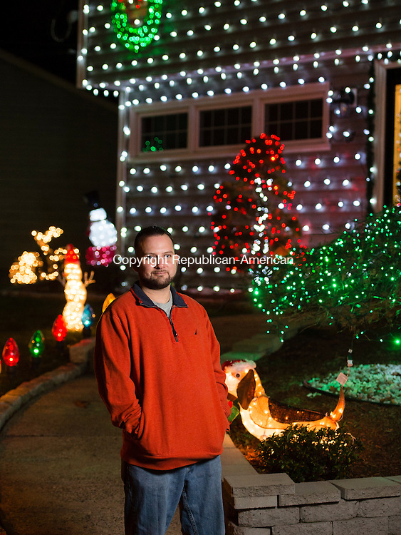 WATERBURY, CT- 17 December 2015-121715EC02-  Michael Sciascia spent over a week decorating his home at 67 Parklawn Drive in Waterbury. Each day he worked over six hours, covering his house and nearby tree (not shown) with lights. Erin Covey Republican-American