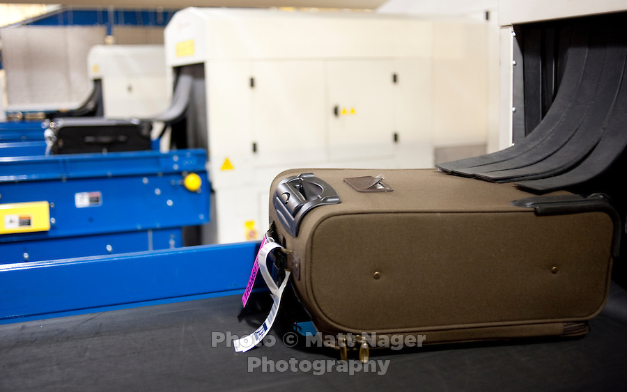 A bag passes through a security machine at Southwest Airlines facilities at Love Field Airport in Dallas, Texas, Wednesday, October 27, 2010...PHOTO/ MATT NAGER