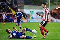 Lincoln City's Sam Habergham vies for possession with Chesterfield's Scott Wiseman<br /> <br /> Photographer Andrew Vaughan/CameraSport<br /> <br /> The EFL Sky Bet League Two - Lincoln City v Chesterfield - Saturday 7th October 2017 - Sincil Bank - Lincoln<br /> <br /> World Copyright &copy; 2017 CameraSport. All rights reserved. 43 Linden Ave. Countesthorpe. Leicester. England. LE8 5PG - Tel: +44 (0) 116 277 4147 - admin@camerasport.com - www.camerasport.com