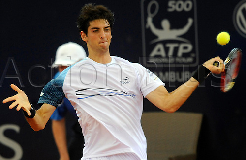 Brazil's Thomaz Bellucci returns a forehand to Germany's Philipp Kohlschreiber during their ATP 2010;German Open round of 16 match at Rothenbaum club in Hamburg, Germany, 22 July 2010.