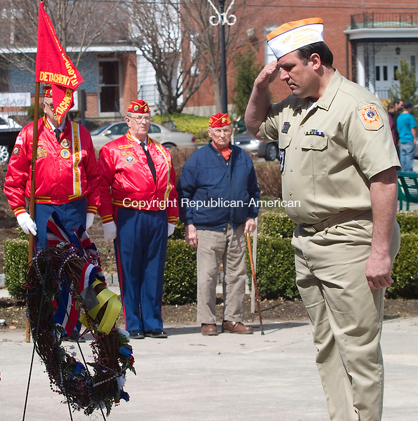 TORRINGTON CT.-30 MARCH  2011 033011DA01- Navy Veteran and Commander of the Veterans of Foreign Wars, Post 9086 in Torrington, Bob Hunter solutes the VFW wreath during the the 1st Annual Welcome Home Vietnam Veterans Day Observance Program held by the Torrington Veterans' Support Committee and its member groups. The ceremony was open to the public to attend and was held at Coe Memorial Park in Torrington on Wednesday.Darlene Douty Republican American