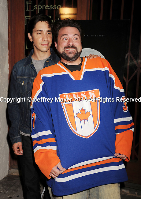 LOS ANGELES, CA- SEPTEMBER 16: Writer/director Kevin Smith (R) and actor Justin Long arrive at the Los Angeles premiere of 'Tusk' at the Vista Theatre on September 16, 2014 in Los Angeles, California.