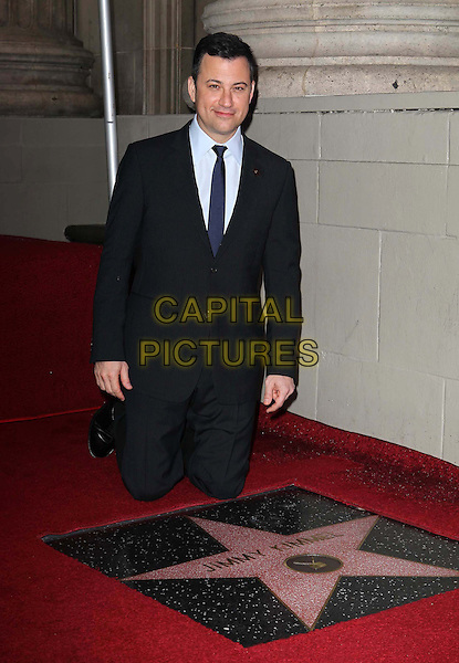 Jimmy Kimmel.Honored With Star On The Hollywood Walk Of Fame in front of El Capitan Entertainment Centre, Hollywood, California, USA, .25th January 2013 .Full kneeling length suit blue tie white shirt grey gray striped jacket pinstripe  pin star brooch .CAP/ADM/KB.©Kevan Brooks/AdMedia/Capital Pictures.