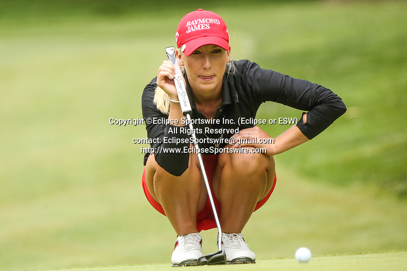 Brooke Pancake reviews the 11th green at the LPGA Championship 2014 Sponsored By Wegmans at Monroe Golf Club in Pittsford, New York on August 16, 2014