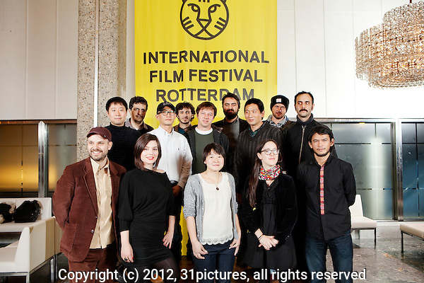 The Netherlands, Rotterdam, 03 February 2012. .The International Film Festival Rotterdam 2012. .Tiger Competition 2012..From left front row: Oskar Thor Axelsson (Black's Game), Maja Milos (Clip), Huang Ji (Egg and Stone), Dominga Sotomayor (De jueves a domingo), Wichanon Somumjarn (In April the Following Year, There Was a Fire);.Second row, from left: Park Hong-Min (A Fish), Kleber Mendonça Filho (Neighbouring Sounds), Lee Kwang-Kuk (Romance Joe), Zeynel Dogan (Voice of my Father), Eduardo Nunes (Sudoeste), Orhan Eskiköy (Voice of my Father), Midi Z (Return to Burma), Vasily Sigarev (Living), Babis Makridis (L).NOT in the picture are: Anka & Wilhelm Sasnal (It Looks Pretty from a Distance), Okuda Yosuke (Playboy Tokyo Club)..Photo: 31pictures.nl / (c) 2012, www.31pictures.nl Copyright and ownership by photographer. FOR IFFR USE ONLY. Not to be (re-)distributed in any form. Copyright and ownership by photographer. FOR IFFR USE ONLY. Not to be (re-)distributed in any form.